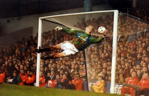 PKT4334-314173 FOOTBALLER - PETER SCHMEICHEL 1994 Manchester United goalkeeper Peter Schmeichel is at full stretch to keep out a header from Steve Sedgley.